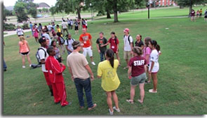 students standing in a circle and talking